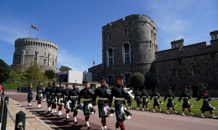 Members of the military arrive for the funeral of Britain's Prince Philip in Windsor Castle, Britain, on April 17, 2021. (Victoria Jones/Pool via Reuters)