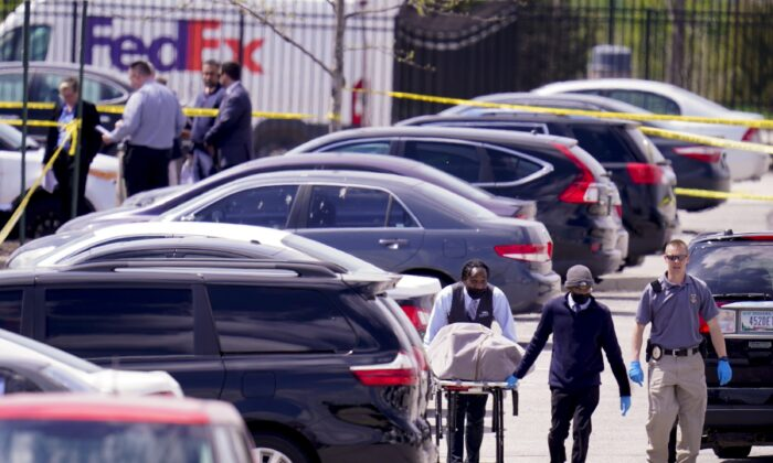 A body is taken from the scene where multiple people were shot at a FedEx Ground facility in Indianapolis, Ind., on April 16, 2021. (Michael Conroy/AP Photo)