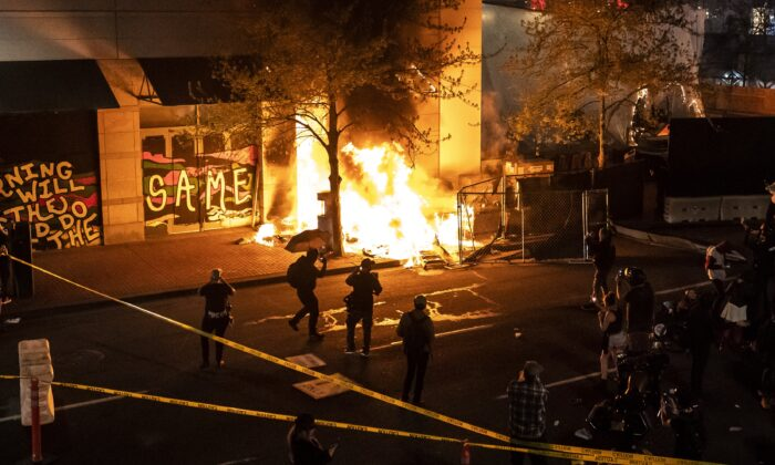 A structure set on fire during a riot burns in Portland, Ore., on April 17, 2021. (Nathan Howard/Getty Images)