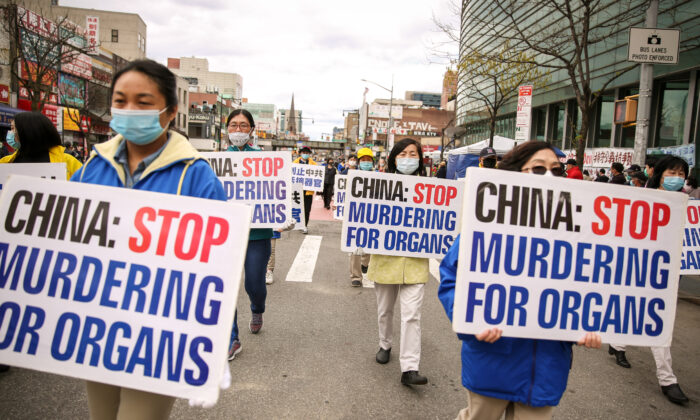 Falun Gong practitioners take part in a parade in Flushing, New York, on April 18, 2021, to commemorate the 22nd anniversary of the April 25th peaceful appeal of 10,000 Falun Gong practitioners in Beijing. (Samira Bouaou/The Epoch Times)