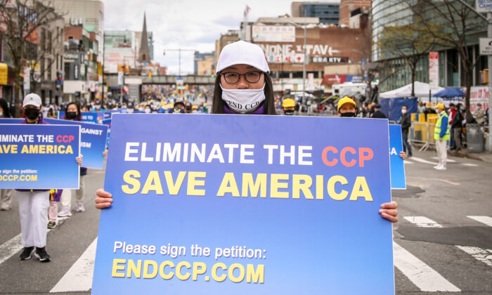 Falun Gong practitioners take part in a parade to commemorate the 22nd anniversary of the April 25th peaceful appeal of 10,000 Falun Gong practitioners in Beijing, in Flushing, N.Y., on April 18, 2021. (Samira Bouaou/The Epoch Times)