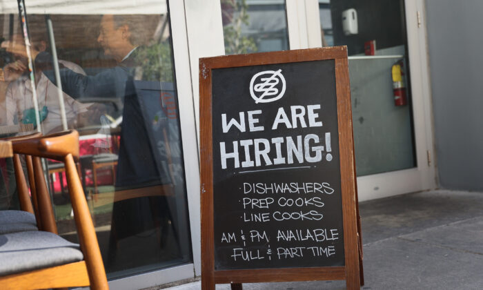 "A ""We are hiring!"" sign is seen in front of the Buya restaurant in Miami, Fla., on March 5, 2021. (Joe Raedle/Getty Images)"