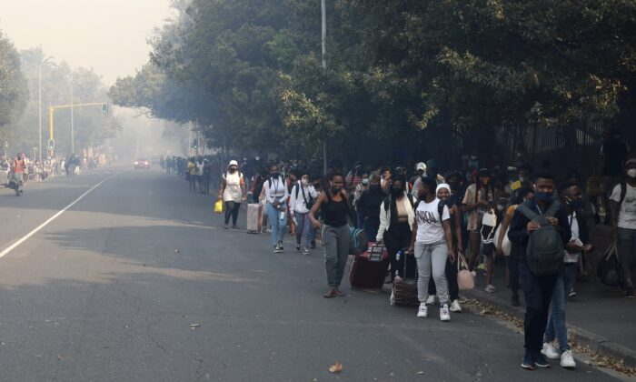 Students make their way after being evacuated from their residence at the University of Cape Town, South Africa, on April 18, 2021. (Nardus Engelbrecht/AP Photo)