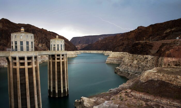 Lightning strikes over Lake Mead near Hoover Dam that impounds Colorado River water at the Lake Mead National Recreation Area in Ariz., on July 28, 2014. (John Locher/AP Photo)