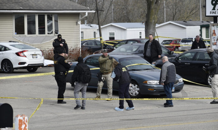 Investigators confer outside the Somers House tavern in Somers, Wis., on April 18, 2021. (Deneen Smith/The Kenosha News via AP)