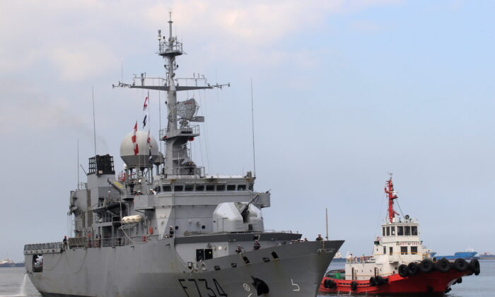 A tugboat escorts French Navy ship Vendemiaire (F734), a Floreal-classlight surveillance frigate of the French Marine Nationale, upon its arrival for a five-day goodwill visit at a port in Metro Manila, Philippines, on March 12, 2018. (Romeo Ranoco/Reuters)