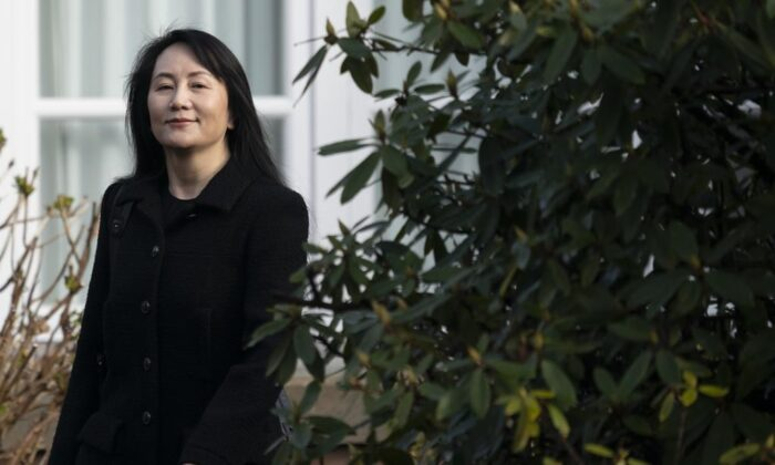 Chief Financial Officer of Huawei, Meng Wanzhou, leaves her home in Vancouver on March 25, 2021, to go to the B.C. Supreme Court. (Jonathan Hayward/The Canadian Press)
