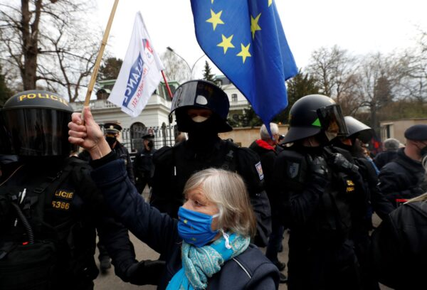 A woman waves a European Union flag