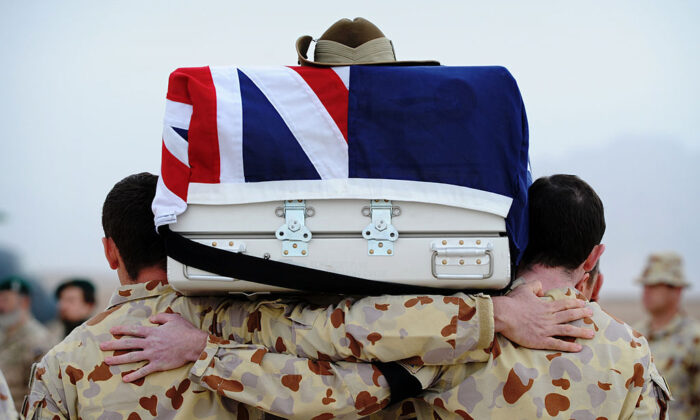 In this handout photo provided by ISAF Regional Command (South), Australian defense engineers carry the casket of their friend and colleague Cpl.  Richard Atkinson at Multinational Base Tarin Kot in Uruzgan, Afghanistan on February 5, 2011. (Australian Cpl. Christopher Dickson/Australian Department of Defense via Getty Images)