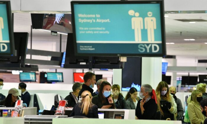 Passengers check in at the counter for New Zealand flights at Sydney International Airport on April 19, 2021, as Australia and New Zealand opened a trans-Tasman quarantine-free travel bubble. (Saeed Khan/Getty Images)