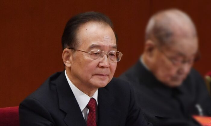 Former Chinese premier Wen Jiabao listens to speeches during the closing session of the rubber-stamp legislature's congress in Beijing, China on Oct. 24, 2017. (GREG BAKER/AFP via Getty Images)