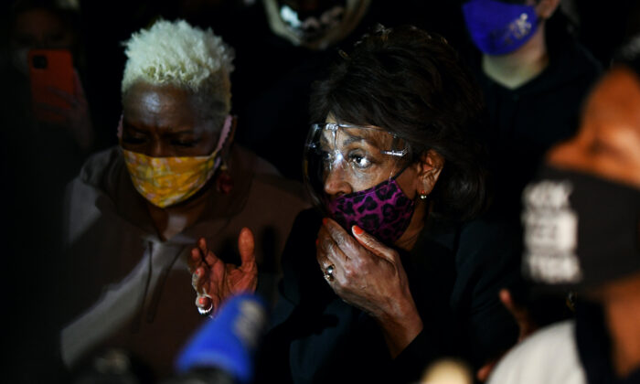 Rep. Maxine Waters (D-Calif.) joins demonstrators in a protest outside the Brooklyn Center police station in Brooklyn Center, Minn., on April 17, 2021. (Stephen Maturen/Getty Images)