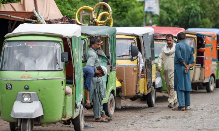 Auto-rickshaw drivers wait for customers on the outskirts of Islamabad, Pakistan, on August 26, 2019. (FAROOQ NAEEM/AFP via Getty Images)