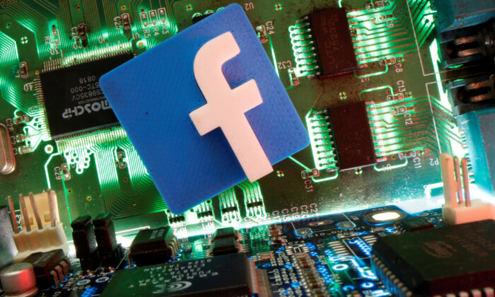 The Facebook symbol is seen on a motherboard in an illustration photograph. (Dado Ruvic/Reuters)