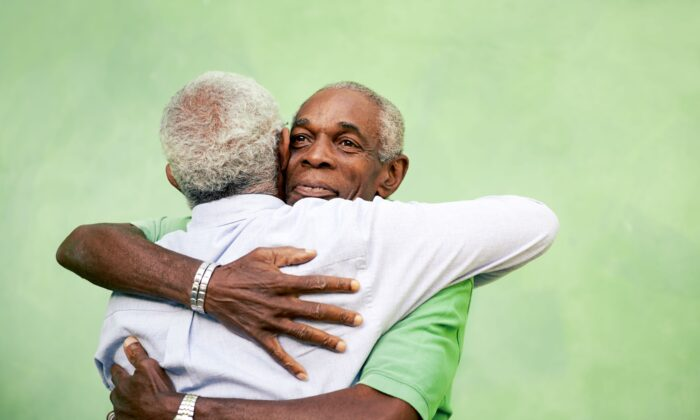 Hugs and handshakes connect us beyond the moment of contact. ( Diego Cervo/Shutterstock)
