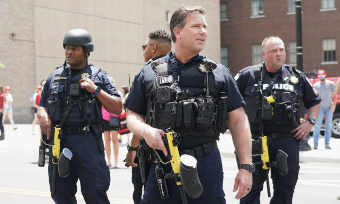 Members of the Tulsa Police Department look on in Tulsa, Okla. on June 20, 2020. (Michael B. Thomas/Getty Images)