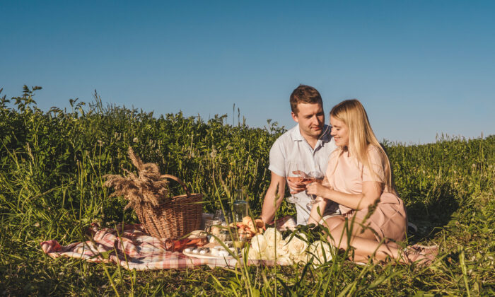 Don't squander a beautiful afternoon or evening by eating indoors. Grab a blanket and some companions, and take your meal outside. (Tatiana Maksimova/Shutterstock)