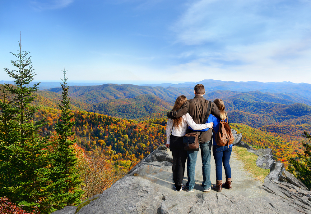 Family,Hiking,In,Autumn,Mountains,Enjoying,Beautiful,Mountain,View.,People