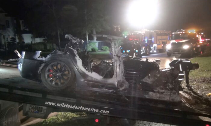The remains of a Tesla vehicle are seen after it crashed in The Woodlands, Texas on April 17, 2021 in this still image from video obtained via social media. (Scott J. Engle via Reuters)