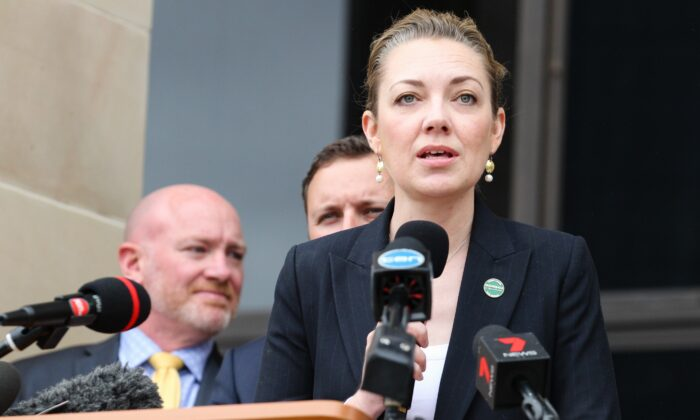 WA National Party leader Mia Davies addresses gold sector workers protesting outside Parliament House in Perth on Tuesday, Oct. 10, 2017. (AAP Image/Richard Wainwright)