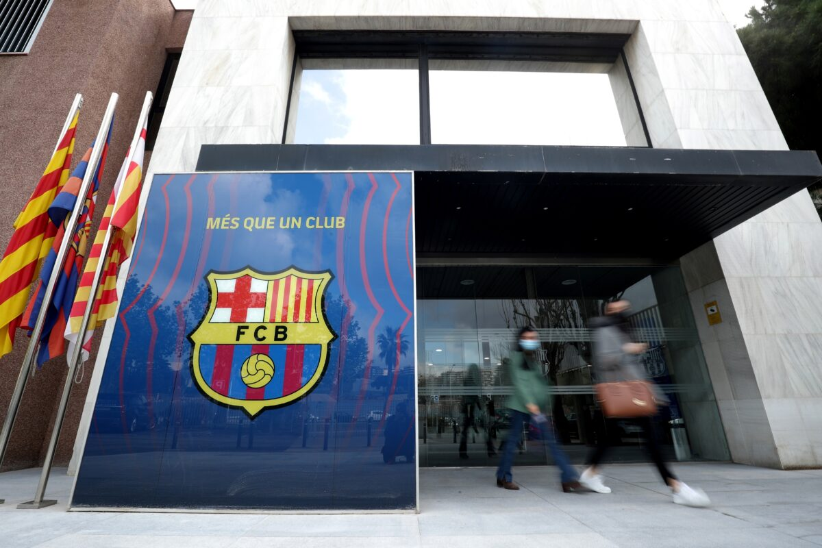 People leave the office of FC Barcelona as twelve of Europe's top football clubs launch a breakaway Super League