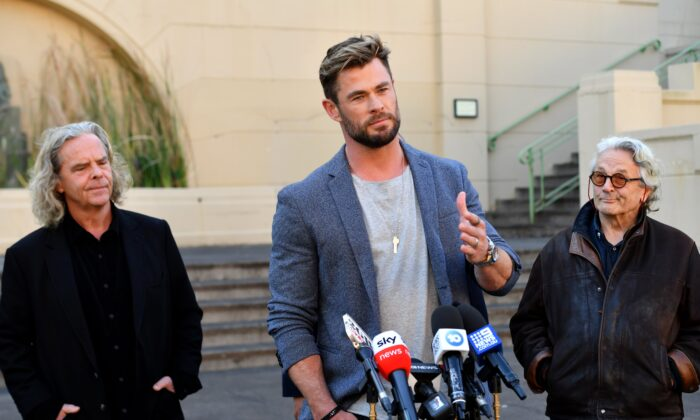 Producer Doug Mitchell, actor Chris Hemsworth and director George Miller at a press conference to announce the new Mad Max film at Fox Studios Australia in Sydney on April 19, 2021. (AAP Image/Mick Tsikas)