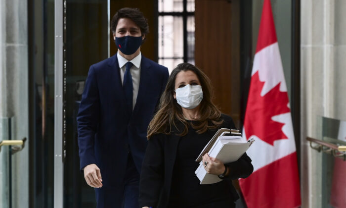 Prime Minister Justin Trudeau and Finance Minister Chrystia Freeland make their way to hold a press conference in Ottawa on April 20, 2021. (The Canadian Press/Sean Kilpatrick)