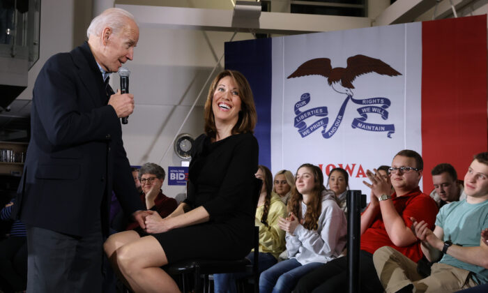 Then presidential candidate and now President Joe Biden (L) is joined by Rep. Cindy Axne (D-Iowa) during a town hall meeting in Ankeny, Iowa, on Jan. 25, 2020. (Chip Somodevilla/Getty Images)