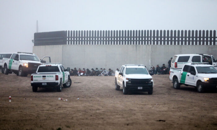 A group of illegal immigrants is processed by Border Patrol after crossing the U.S.-Mexico border in La Joya, Texas, on April 10, 2021. (Charlotte Cuthbertson/The Epoch Times)