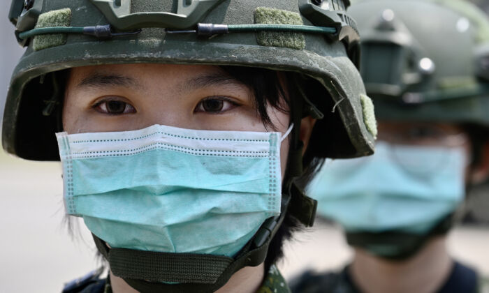 A female soldier stands in formation during Taiwan President Tsai Ing-wen's visit to a military base in Tainan, southern Taiwan, on April 9, 2020. (Sam Yeh/AFP via Getty Images)