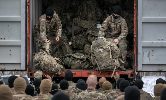U.S. Army soldiers from the 10th Mountain Division retrieve their duffel bags after they returned home from a 9-month deployment to Afghanistan at Fort Drum, New York on Dec. 10, 2020. (John Moore/Getty Images)
