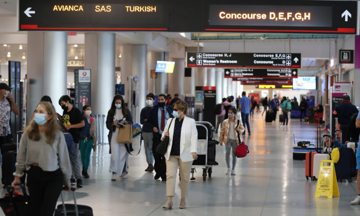 Travelers walk through Miami International Airport, Fla., on Feb. 1, 2021. (Joe Raedle/Getty Images)