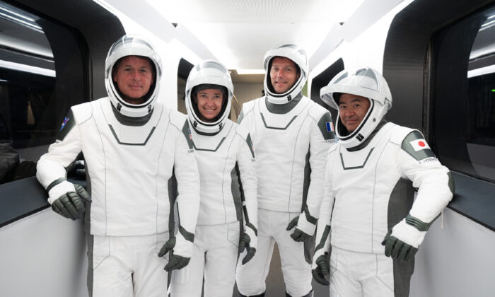 NASA astronauts Shane Kimbrough, from left, and Megan McArthur, European Space Agency astronaut Thomas Pesquet, and Japan Aerospace Exploration Agency astronaut Akihiko Hoshide during a dress rehearsal at the Kennedy Space Center in Cape Canaveral, Fla., on April 18, 2021. (SpaceX via AP)