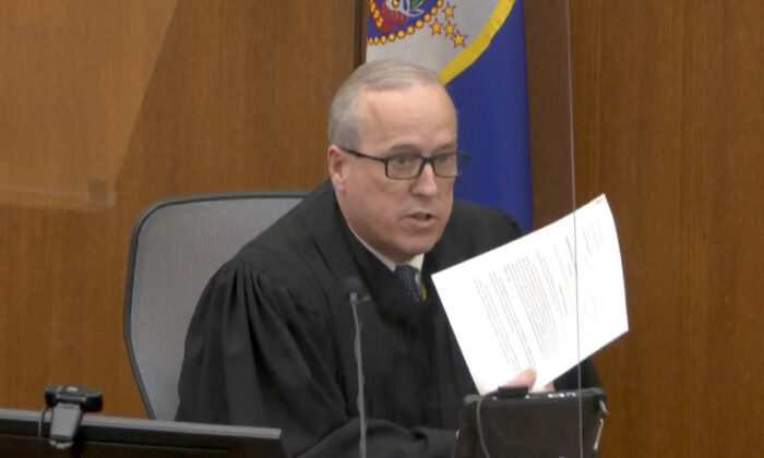 Hennepin County Judge Peter Cahill reads instructions to the jury before closing arguments at the Hennepin County Courthouse, Minn., on April 19, 2021.  (Court TV via AP/Pool)