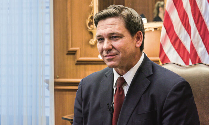 Floridа Gov. Ron DeSantis is seen during a meeting at the governor's office in Tallahassee, Fla., on April 1, 2021. (The Epoch Times)