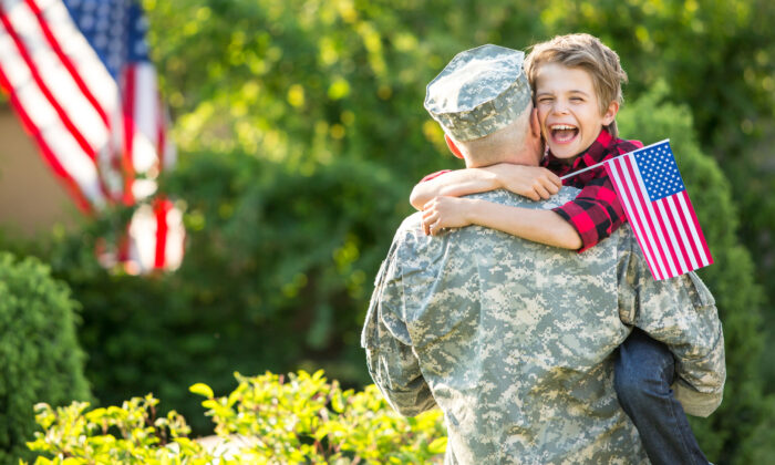 Through modeling and discussions, parents can pass on love of liberty and country to their children. (PEPPERSMINT/Shutterstock)