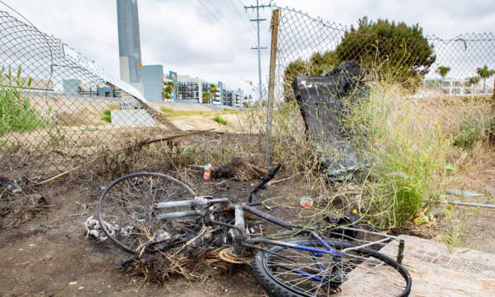 Burned items are found along the 91 freeway April 21, 2021 near the area a homeless man died in an Anaheim, Calif., fire. (John Fredricks/The Epoch Times)