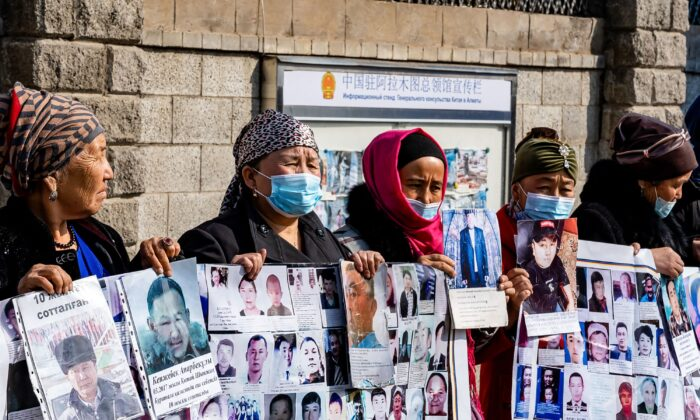 A group of female protestors demand safe passage home for their relatives, who are missing, jailed or trapped in China's Xinjiang region outside the Chinese consulate in Almaty, Kazakhstan on March 9, 2021.  (Abduaziz Madyrovi/AFP via Getty Images)