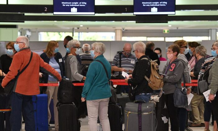 Passengers wait at the check-in counters for New Zealand flights at Sydney International  Airport on April 19, 2021, as Australia and New Zealand opened a trans-Tasman quarantine-free travel bubble. (Saeed Khan/Getty Images)