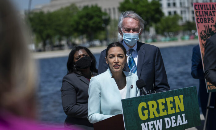 Rep. Alexandria Ocasio-Cortez (D-N.Y.) speaks at a news conference held to re-introduce the Green New Deal, in Washington, on April 20, 2021. (Sarah Silbiger/Getty Images)