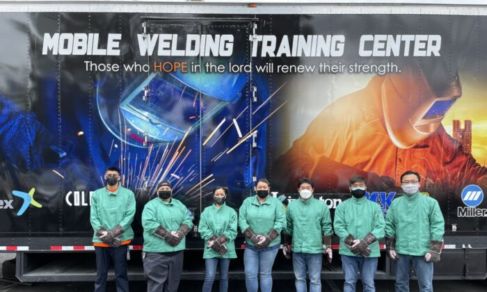 Students attend a mobile welding class through ReIGNITE Hope, which helps former gang members, homeless people, and ex-offenders rebuild their lives by learning a trade. (Courtesy of ReIGNITE Hope)