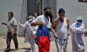 Citizen Volunteers Lead India COVID-19 Relief Effort as Cases Rise to Record Numbers