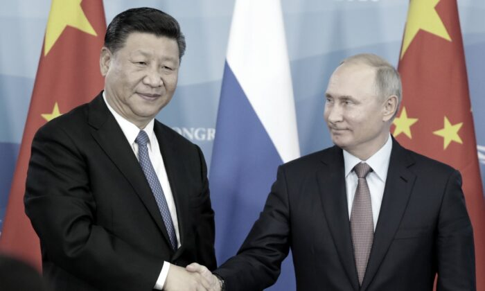 Russian President Vladimir Putin (R) shakes hands with Chinese leader Xi Jinping during a signing ceremony following the Russian-Chinese talks on the sidelines of the Eastern Economic Forum in Vladivostok on Sept. 11, 2018. (Sergei Chirikov/AFP/Getty Images)