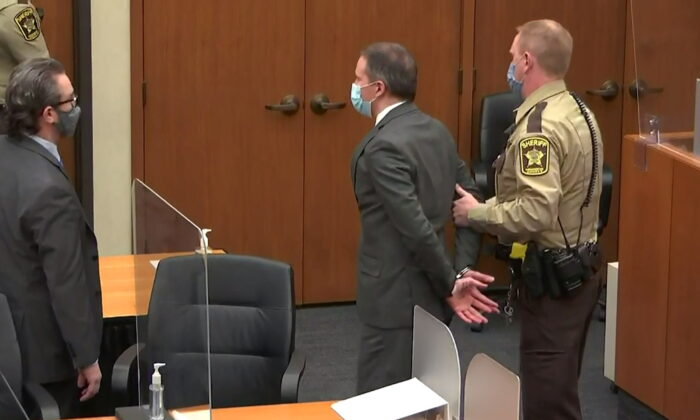 In a still image from video, former Minneapolis police officer Derek Chauvin is led away in handcuffs after a jury found him guilty of all charges in his trial for second-degree murder, third-degree murder and second-degree manslaughter in the death of George Floyd in Minneapolis, Minn., on April 20, 2021. (Pool via Reuters)