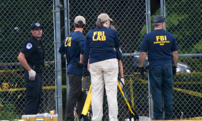 Members of the FBI gather at the crime scene after a shooting during a practice of the Republican congressional baseball team at Eugene Simpson Stadium Park in Alexandria, Va., on June 14, 2017. (Paul J. Richards/AFP via Getty Images)