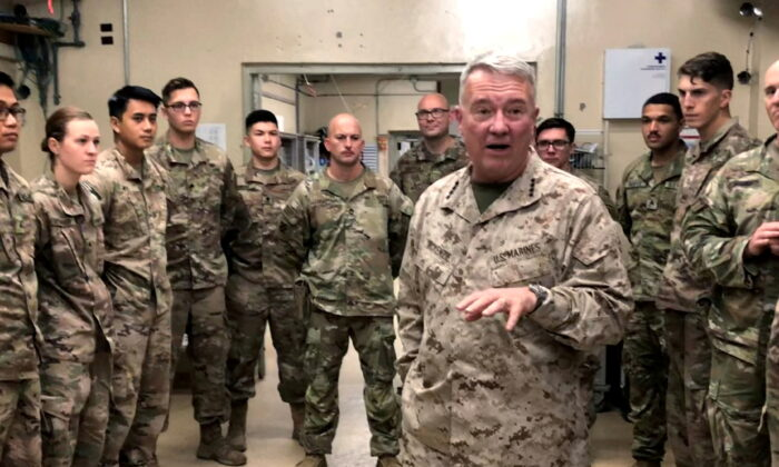 Marine General Kenneth McKenzie, head of U.S. Central Command, speaks with U.S. troops while visiting Forward Operating Base Fenty in Jalalabad, Afghanistan, on Sept. 9, 2019. (Phil Stewart/Reuters)