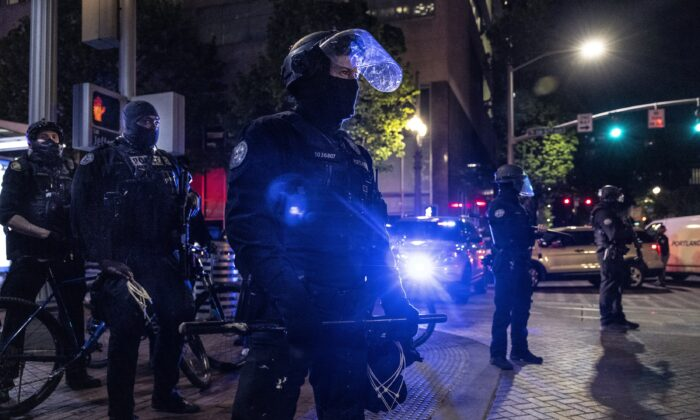 Portland police officers in downtown Portland, Ore., on April 20, 2021. (Paula Bronstein/Getty Images)