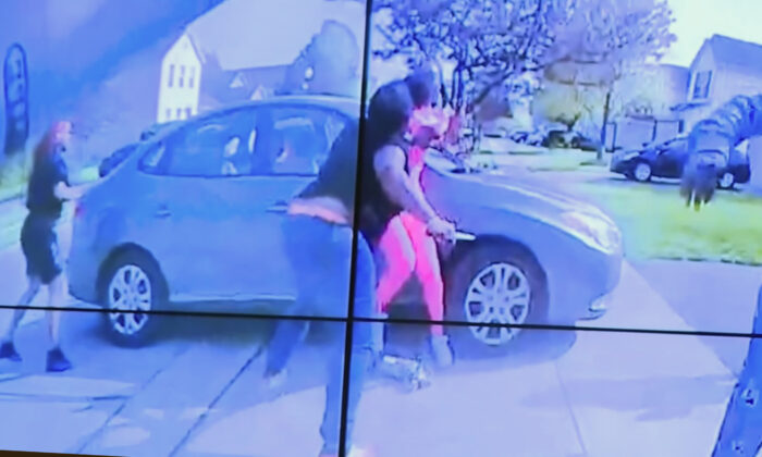 In an image from police bodycam video that the Columbus Police Department played during a news conference on April 20, 2021, a teenage girl, foreground, appears to wield a knife during an altercation before being shot by a police officer  in Columbus, Ohio, on  April 20, 2021. (Columbus Police Department via WSYX-TV via AP)