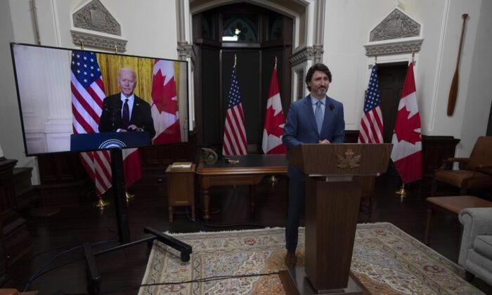 Canadian Prime Minister Justin Trudeau looks at United States President Joe Biden as he delivers a statement during a virtual joint statement in Ottawa, on February 23, 2021. (THE CANADIAN PRESS/Adrian Wyld)