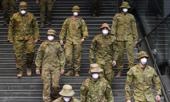 MELBOURNE, AUSTRALIA - JULY 27: Members of the Australian Defence Force walk through the city on July 27, 2020 in Melbourne, Australia. (Photo by Quinn Rooney/Getty Images)